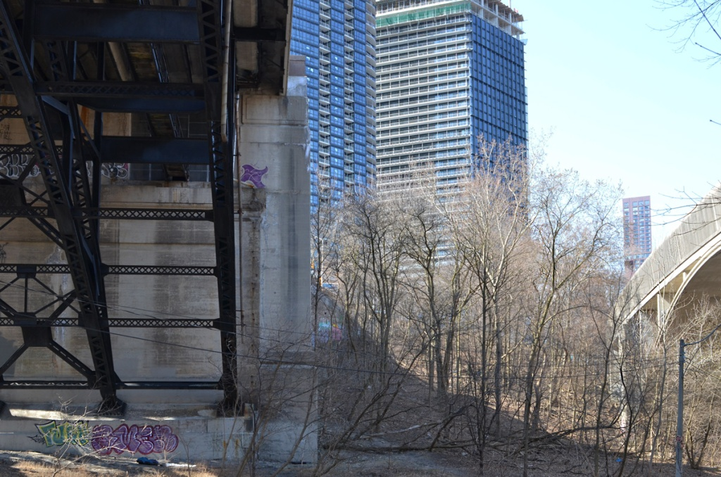 two bridges, Bloor street east on the left and covered subway bridge on the right, in the distance, condos and tall buildings on Bloor Street