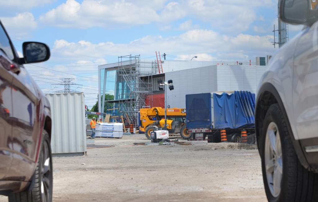 as seen from between two cars, the new Kennedy LRT station under construction