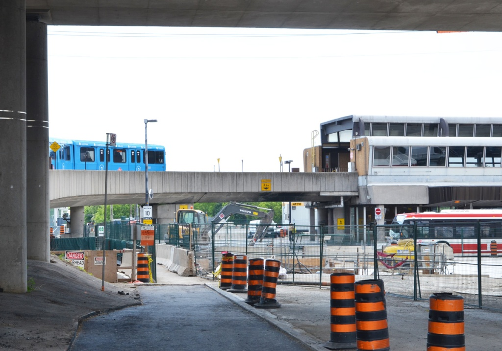 blue TTC sheppard line subway train enters Kennedy station after going up the curved concrete ramp