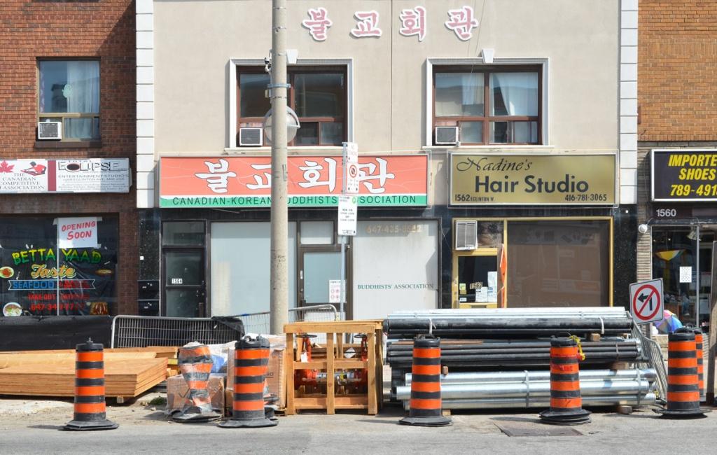 Canadian Korean Buddhists Association storefront on Eglonton West beside Nadines Hair Studio and Bettayaad Taste seafood