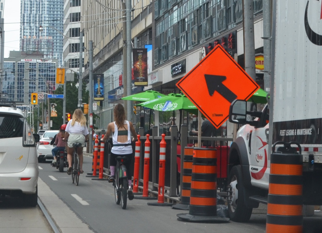 traffic, cyclists, construction cones, patio, on Dundas looking towards Bay street