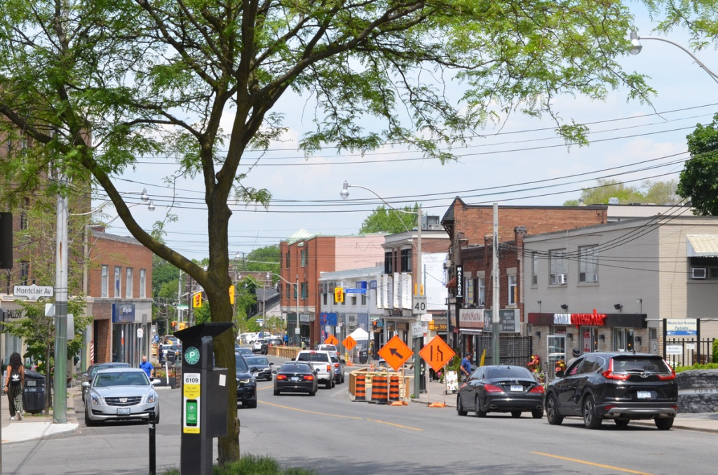 Spadina and Montclair Ave., Forest Hill village shops and business district.  Construction signs, cars and traffic