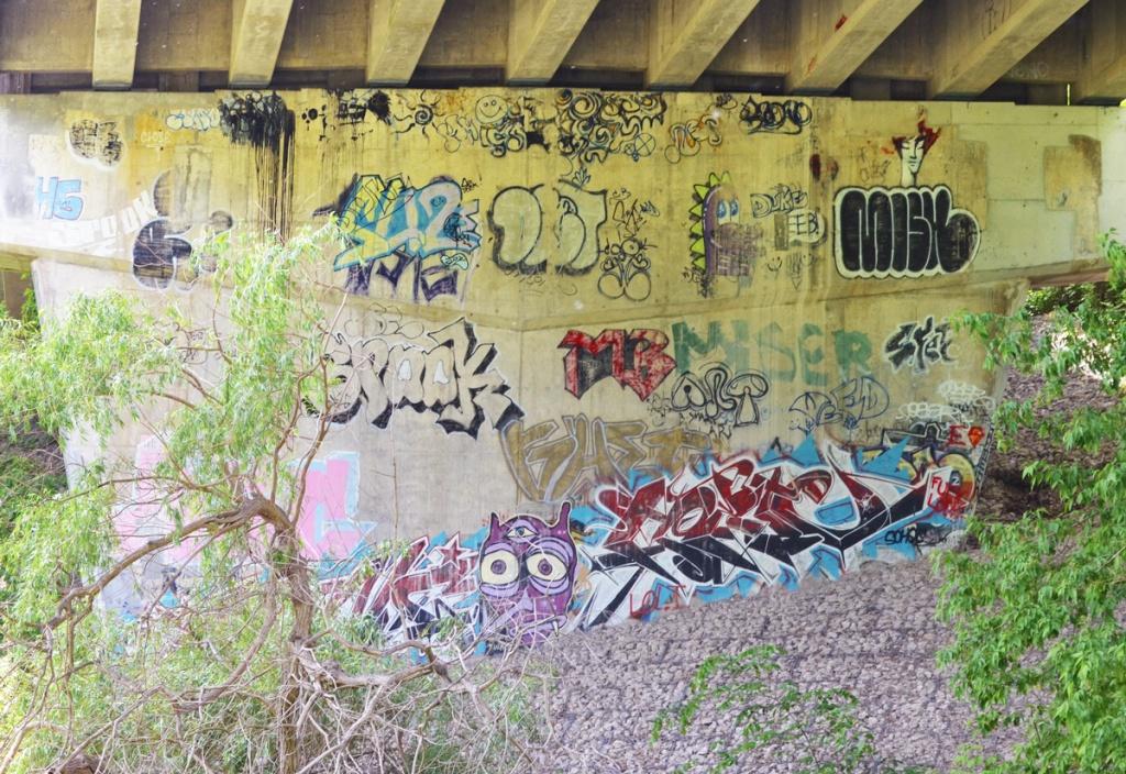 graffiti on the concrete supports of a bridge