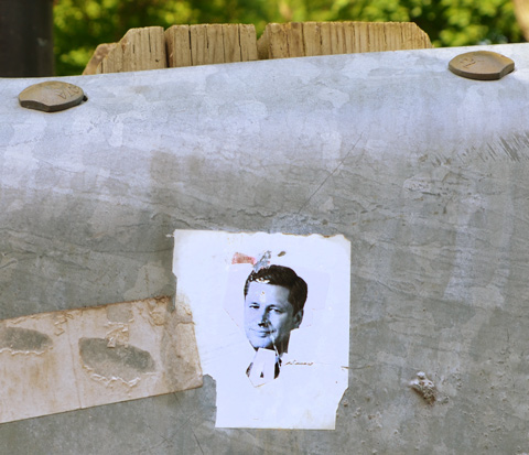 graffiti stick with ex-Prime Minister Stephen Harper's face on it