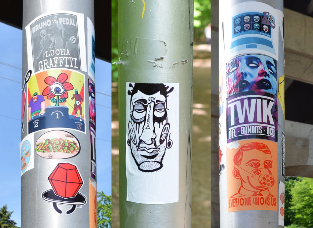 3 poles with stickers on them
