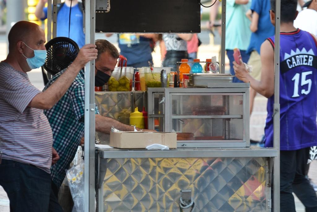 hot dog and sausage street vendors at work