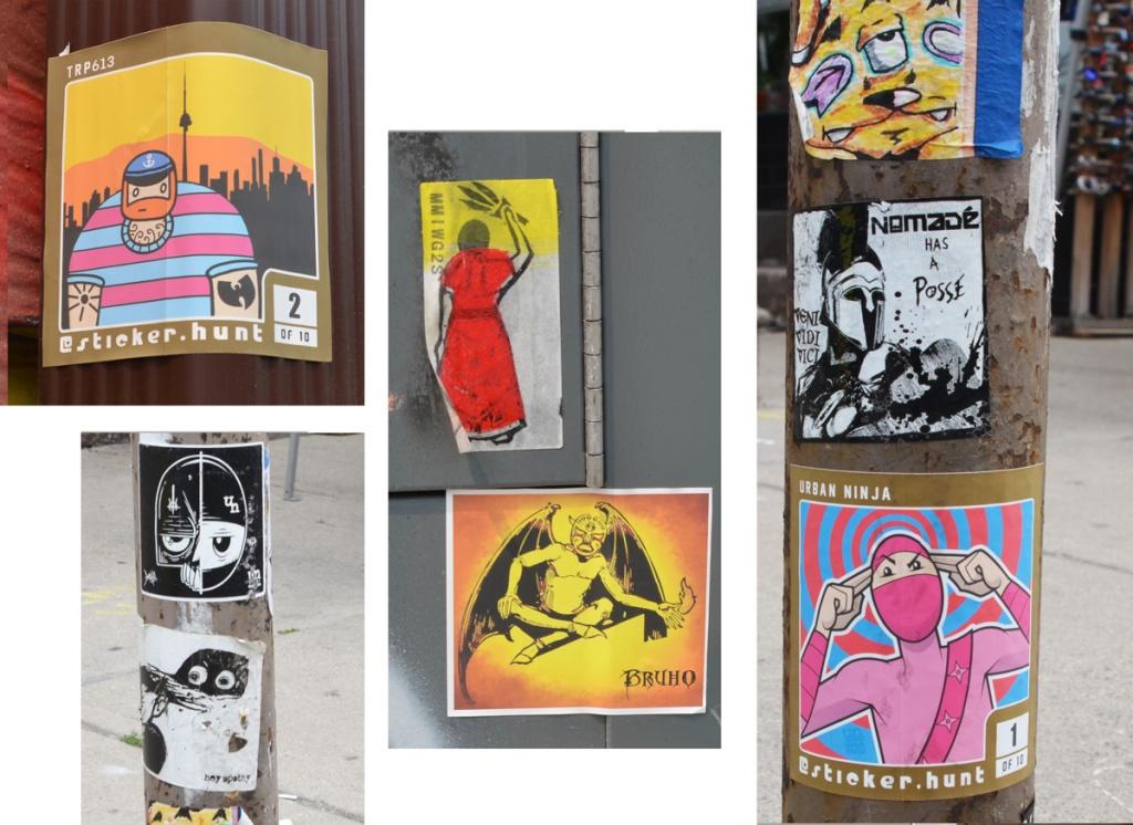 graffiti stickers on poles in Kensington