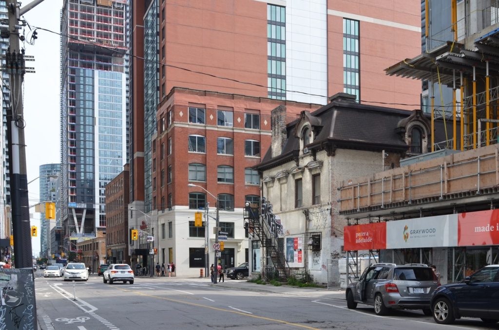 West side of Peter at Adelaide.  New tall buildings except older beige building on the northwest corner.