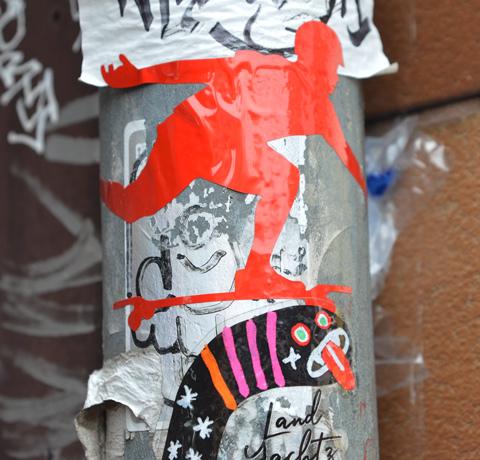 graffiti slap of a bright shiny red skateboarder on the move