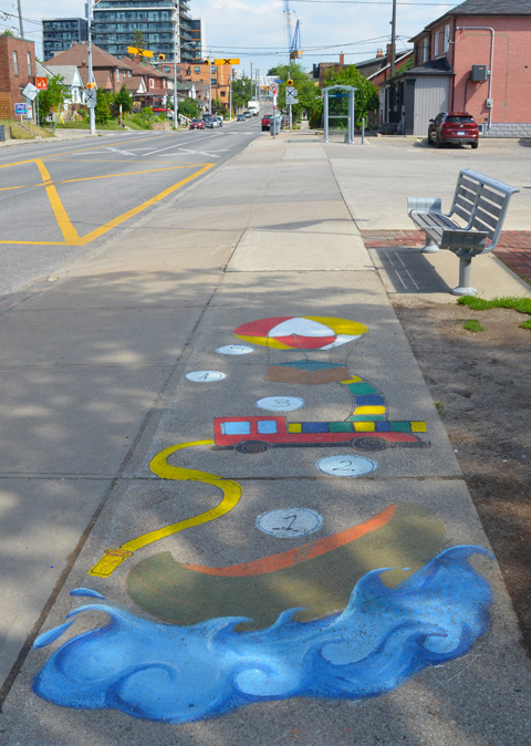paintings on sidewalk, game with numbers 1, 2, 3, 4, and 5, blue water a truck, and a hot air balloon