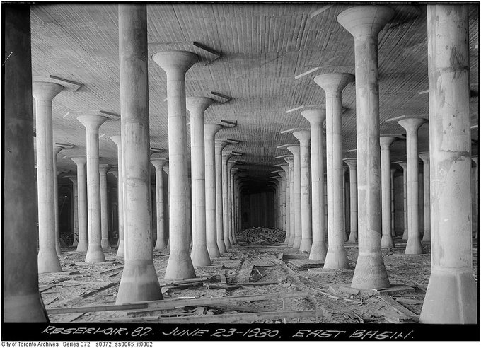 old black and white photo from City of Toronto archives of east basin of St. Clair Water Reservoir when its empty