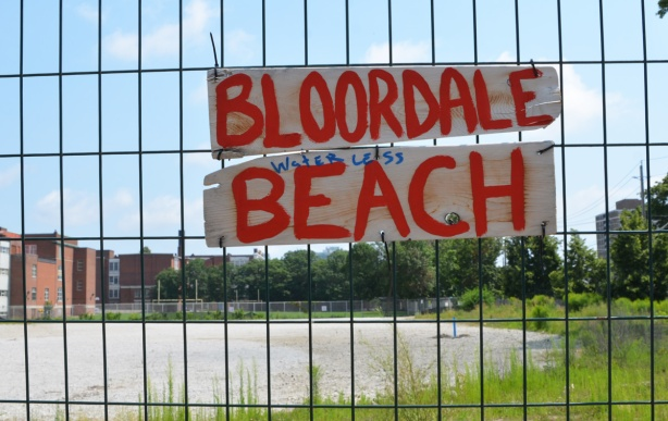 sign on fence that says Bloordale waterless beach