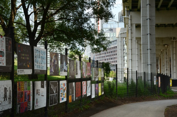 OCADU art display on fence between Fort York and the Bentway