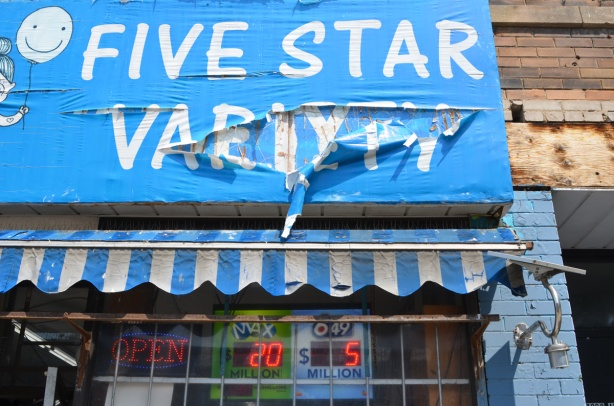 torn blue awning above Five Star Variety