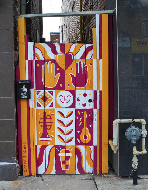 a gate painted in orange, maroon, sand white by anastatica art