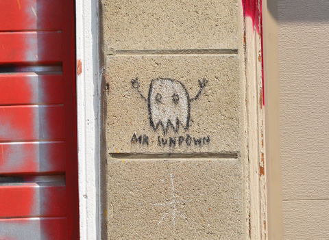 little white graffiti ghost character with stick arms, Mr. Sundown