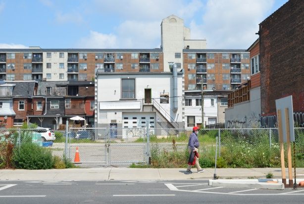 a man walks by a vacant lot on Bloor street