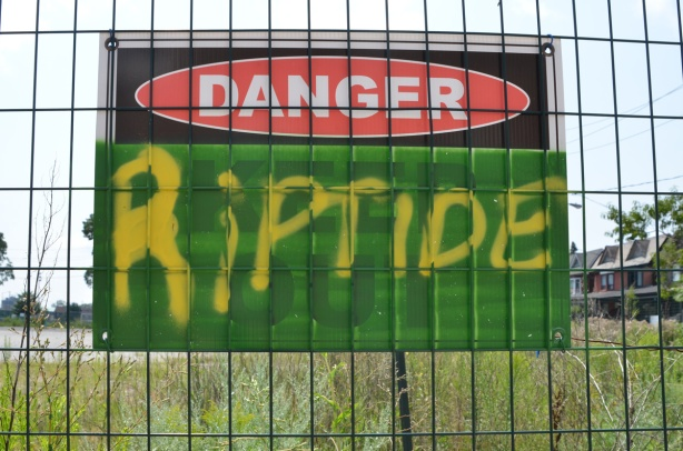 sign on fence that says danger riptide