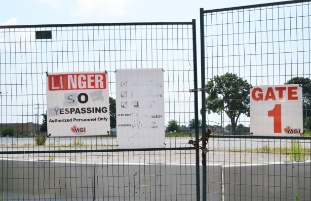 danger no trespassing sign has been altered to read linger so yespassing