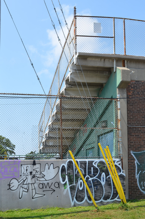 concrete stairs from the back, to the upper level of stadium seating