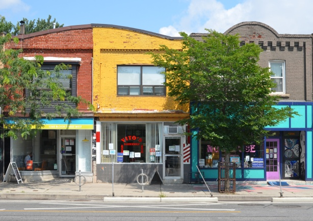vitos barbershop and other two storey buildings on Bloor