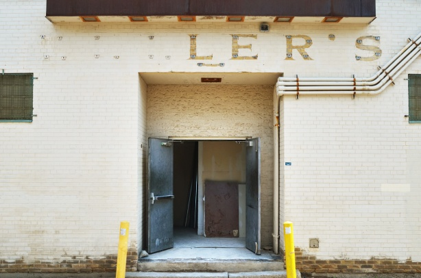 back entrance, open doors, of what used to be Zellers. Some of the letters of the name are still there, l e r s