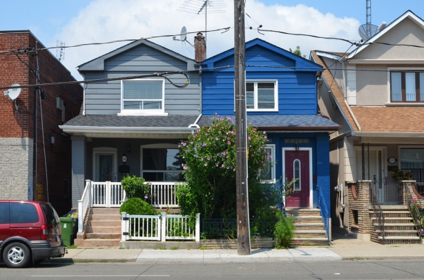 two blue houses, semis, one bright blue and greyish blue.