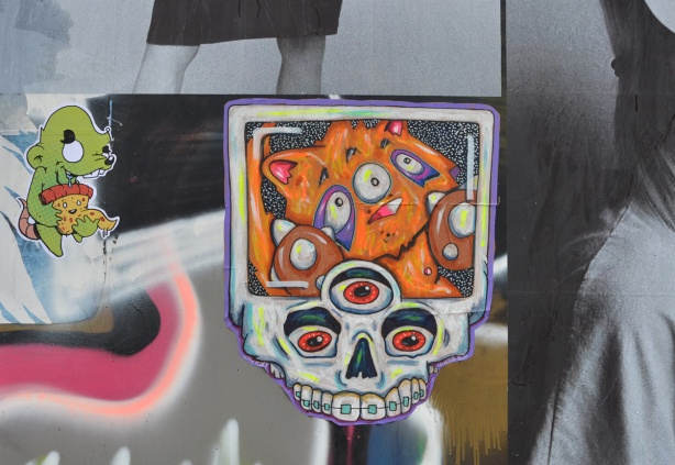 paste platz, wheatpaste papers on a wall, City Kitty design in skull