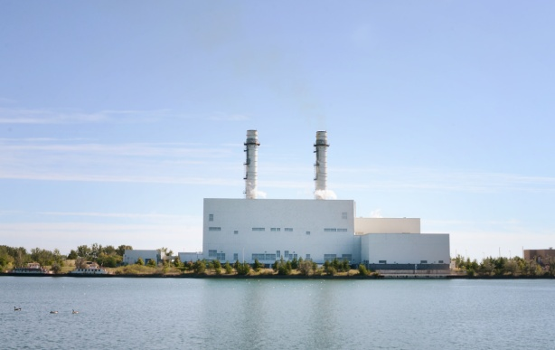 gas powered electric station on the shores of the Shipping Channel in the port lands, large white building with 2 tall smoke stacks