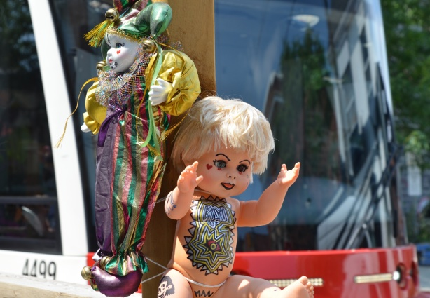 dolls attached to poles as part of decoration on outdoor patio