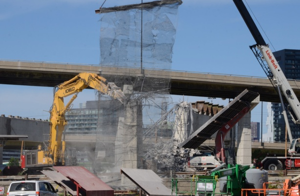demolishing concrete bents under the Gardiner, catching debris in nets and on sliders that direct rubble to piles