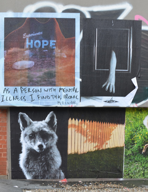 paste platz, wheatpaste papers on a wall, photo of town of Hope BC sign that says Experience hope, with words As a person with mental illness, I find this ironic