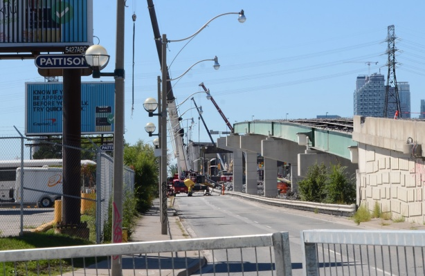 side view, Lakeshore looking west from Bouchette, middle of Gardiner demolition, road surface is missing but steel structure is still there