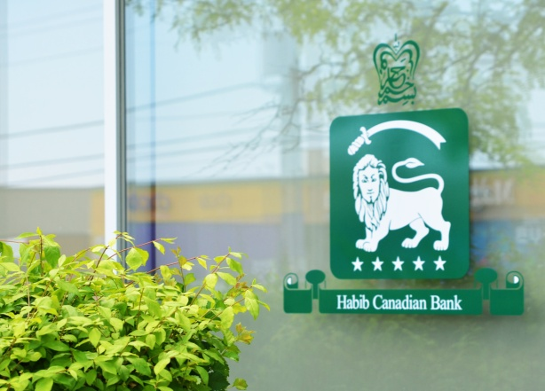 green and white symbol of Habib bank, white lion with a sword above it