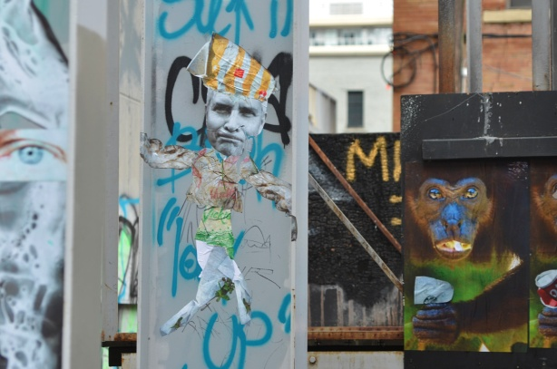 paste platz, wheatpaste papers on a wall, monkeys with cans