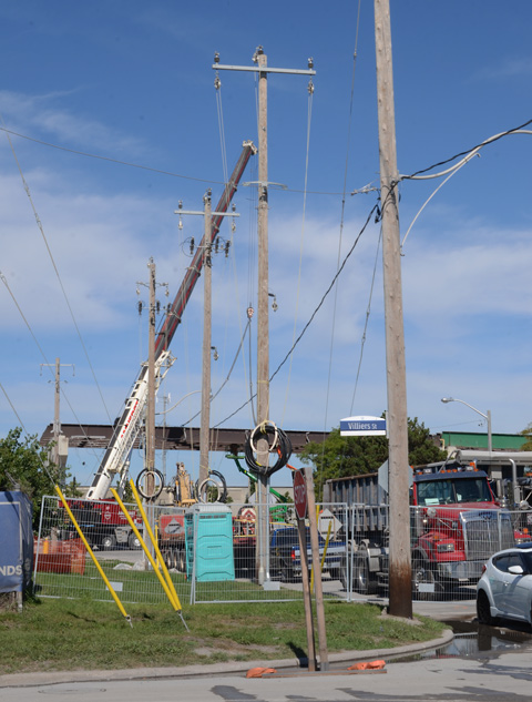 new utility poles at a construction site, hydro poles