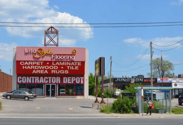 large pink and red store, contractor depot, on kennedy road,