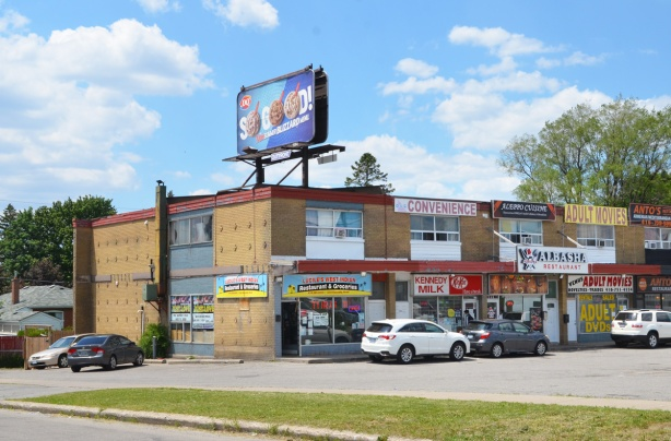 two storey brick plaza with many stores