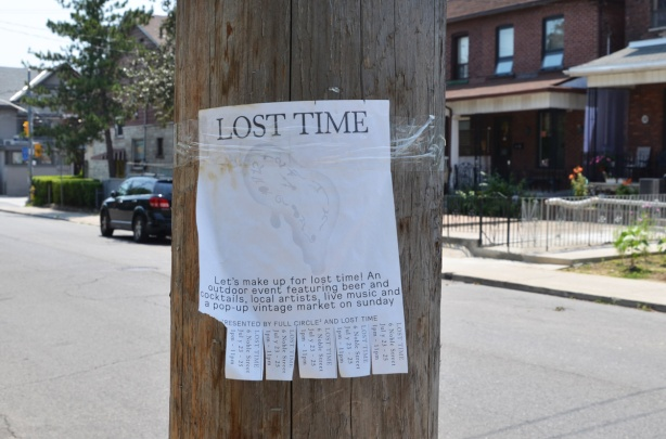 poster on a wood utility pole with the headline Lost Time