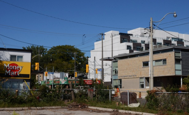view from a vacant lot at Lower Coxwell and Eastern, looking northeast towards Coxwell and Queen East intersection