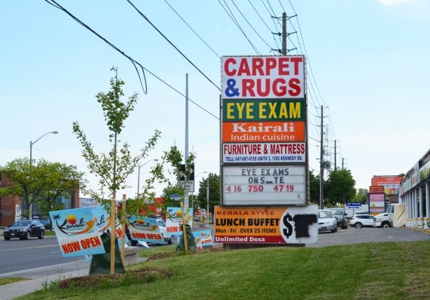 signs for stores along Kennedy road