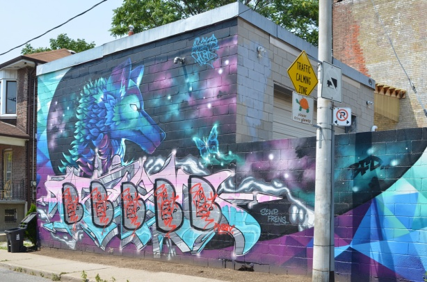 tagged mural, mural was an animal in blues on purple astro like background