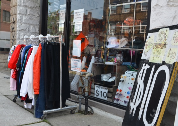 store, with items of clothing on display outside