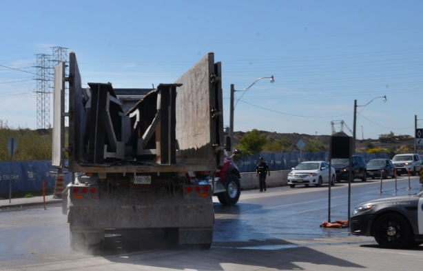 truck taking away girders that have been removed