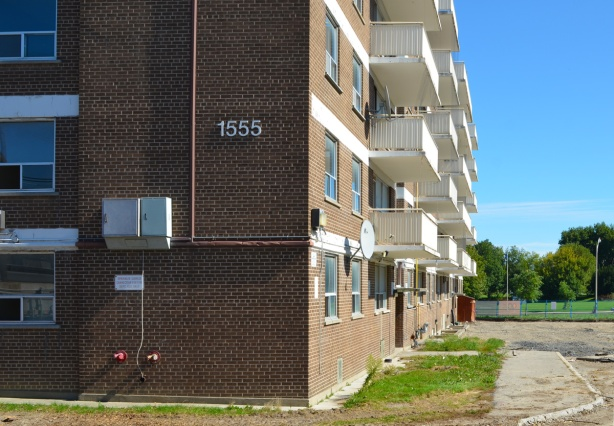 empty apartment building at 1555 Queen East