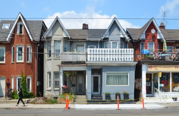 semi divided house with peaked roof, balconies on upper level