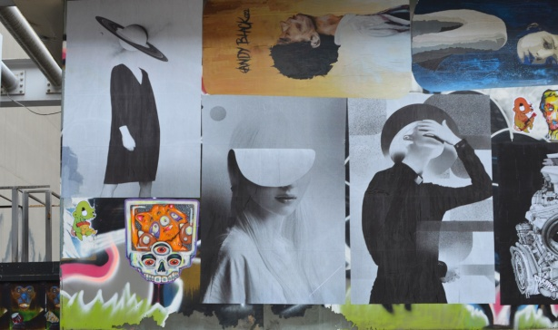 paste platz, wheatpaste papers on a wall, three large pictures in black and white of women