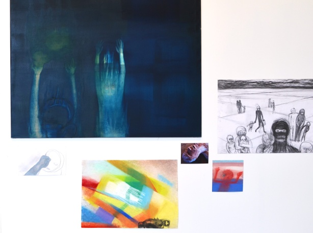 a number of paintings by Mirian Cahn on an art gallery wall