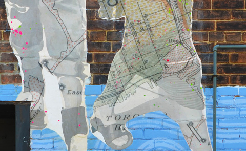 detail of map on legs of people in photos printed on maps
