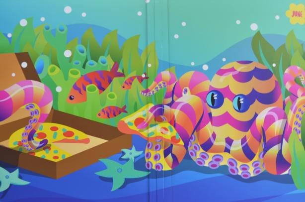 stylized marine scene, pink and yellow striped octopus, fish, starfish,